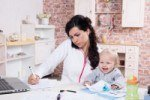 Mother and Baby in Home Office under Work-Life Grant